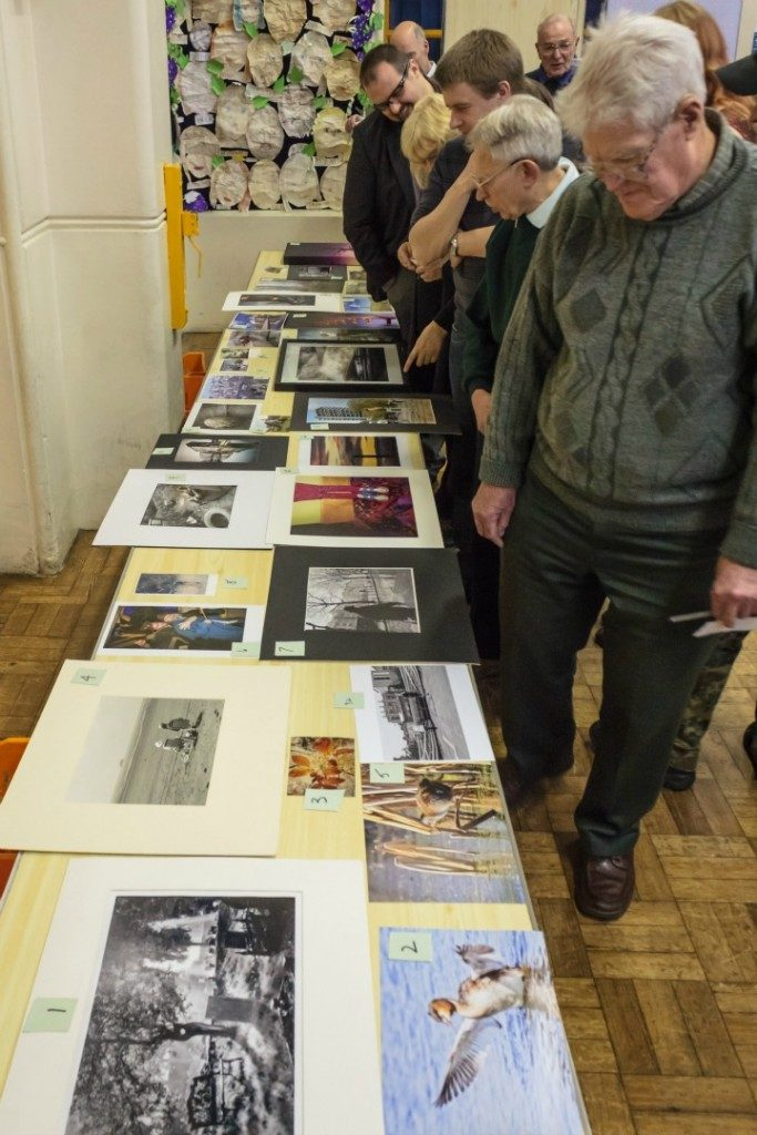 Reflex Camera Club members looking over the entries in a 'just for fun' competition that was held