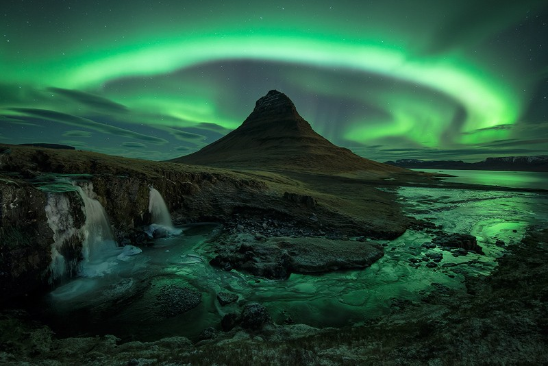 Aurora over Kirkjufell in Iceland by David Clapp